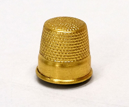 goldener Fingerhut als Magnet