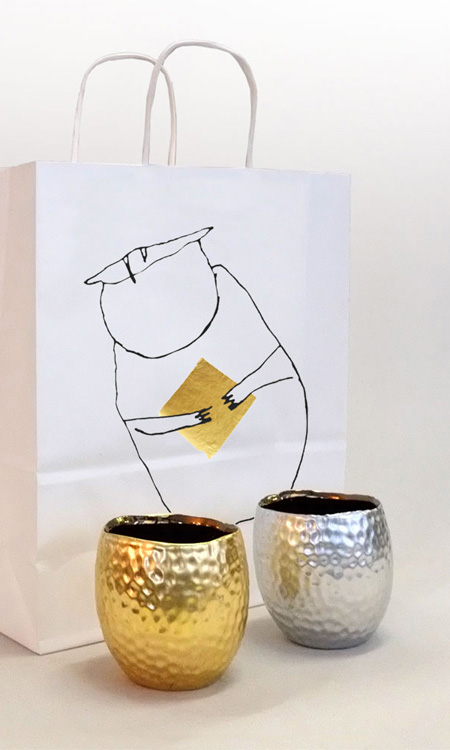 mit Blattaluminium und Blattmessing belegte Teelichter